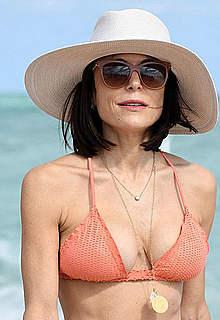 Bethenny Frankel in a peach bikini on a beach