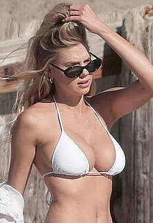 Charlotte McKinney sexy in bikini on a beach