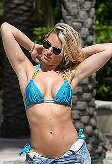 Danielle Armstrong in blue bikini on a beach