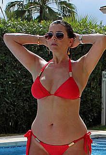 Imogen Thomas sexy in red bikini poolside
