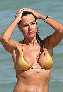 Kelly Bensimon pokies in sexy yellow bikini