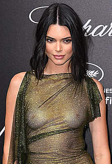 Kendall Jenner topless under see through dress