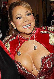 Mariah Carey shows sexy cleavage on a stage
