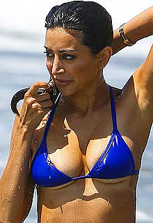 Noureen DeWulf boobs out from her blue bikini